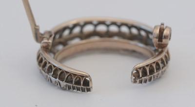 Lot 1 - A diamond crescent brooch.