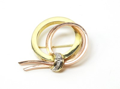 Lot 4 - Mid 20th C yellow and rose coloured metal and diamond brooch.