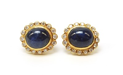 Lot 5 - A pair of sapphire and diamond cluster earrings.