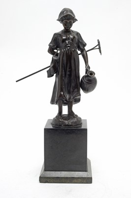 Lot 796 - E. Fülleorn: a brown patinated bronze model of a Dutch girl.