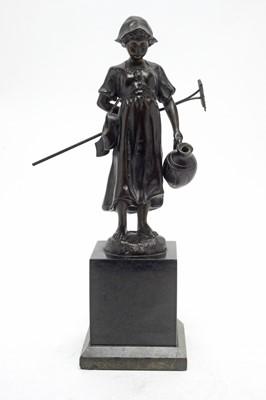 Lot 435 - E. Fülleorn: a brown patinated bronze model of a Dutch girl.