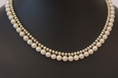 Lot 189 - Cultured pearl necklaces and a brooch