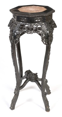 Lot 884 - Chinese carved hardwood octagonal jardiniere stand.