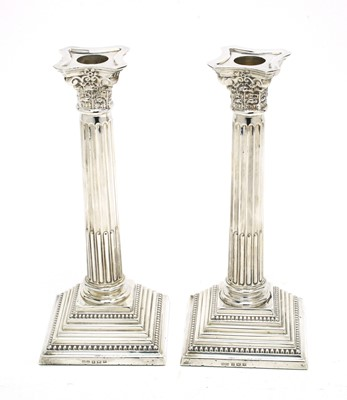Lot 180 - A pair of Elizabeth II silver candlesticks.