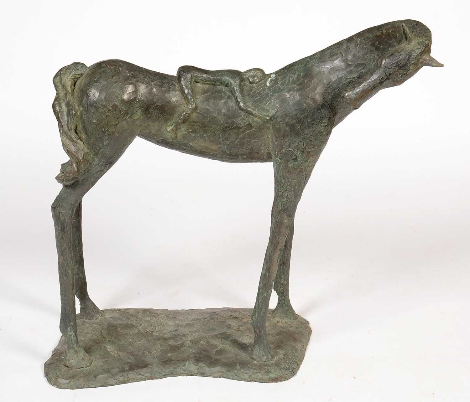 Lot 780 - A contemporary resin model of a small figure resting on a horse