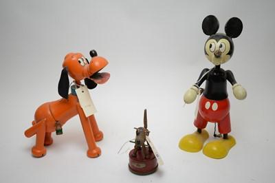 Lot 352 - A pair of painted wooden Walt Disney money...