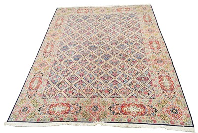 Lot 648 - Antique Kirman carpet