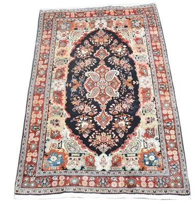 Lot 669 - Fine antique Kashan rug