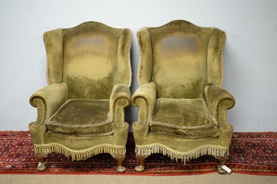 Lot 63 - Pair of early 20th C wing back armchairs.