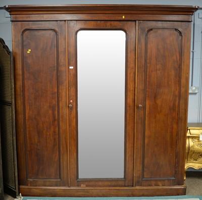 Lot 116 - A Victorian mahogany three-door wardrobe, the...