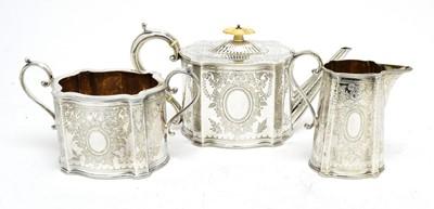 Lot 158 - A Victorian silver three-piece tea service.