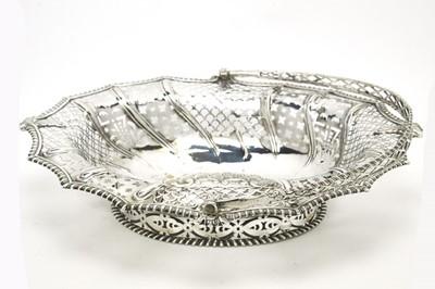 Lot 146 - A George III silver basket.