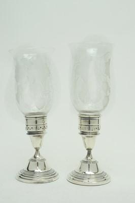 Lot 188 - A pair of Elizabeth II silver candlesticks.