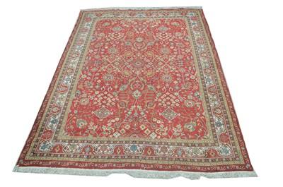 Lot 624 - A Tabriz carpet.