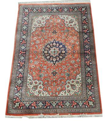 Lot 635 - A modern silk Persian rug.