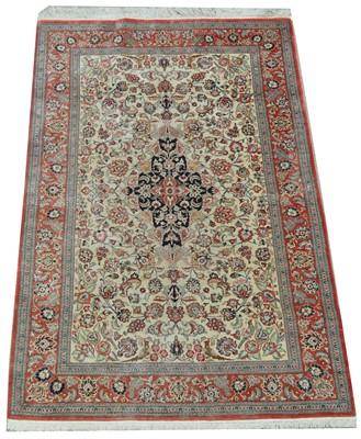 Lot 636 - A modern Persian silk rug.