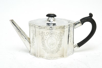Lot 143 - A George III silver teapot.