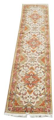 Lot 746 - A fine part silk Tabriz runner