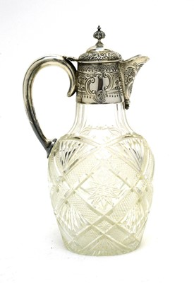 Lot 173 - Silver mounted cut glass claret jug