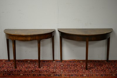 Lot 18 - Two 19th C mahogany demi lune side tables.