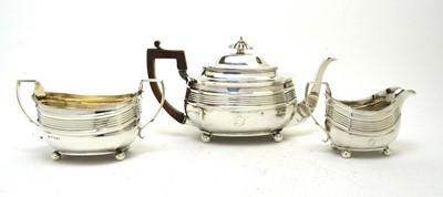 Lot 174 - George III silver three piece tea service