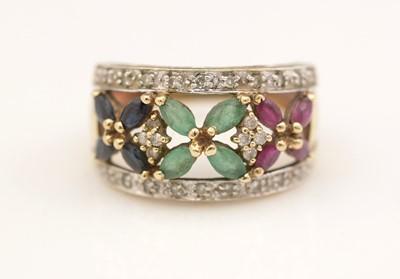 Lot 311 - A gem-set dress ring.