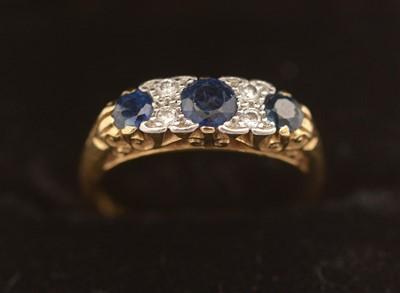 Lot 310 - Sapphire and diamond ring.