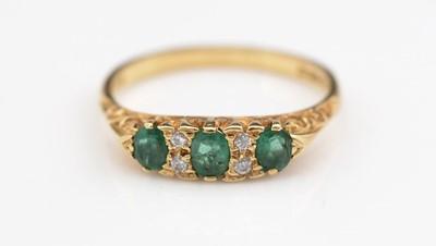 Lot 309 - Emerald and diamond ring.