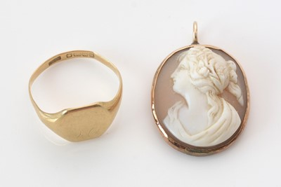 Lot 295 - 18ct. yellow gold signet ring; and a carved shell Cameo.