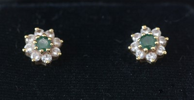 Lot 289 - A pair of emerald and diamond cluster earrings.