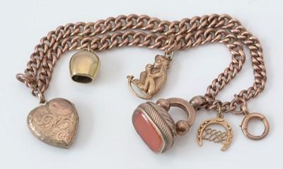 Lot 151 - 9ct. rose gold charm bracelet.