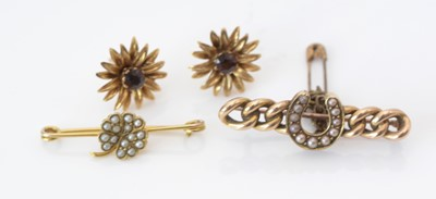 Lot 279 - Pair of earrings and two brooches.