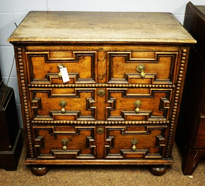 Lot 128 - 18th C geometric fronted chest of drawers.