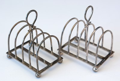 Lot 262 - Pair of silver five bar toast racks.
