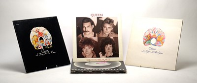 Lot 954 - Queen LPs and singles