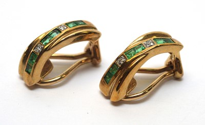 Lot 233 - A pair of emerald and diamond earrings
