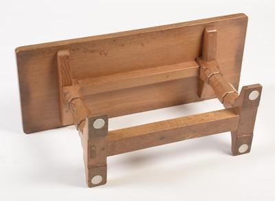 Lot 805 - Workshop of Robert 'Mouseman' Thompson: an oak coffee table.