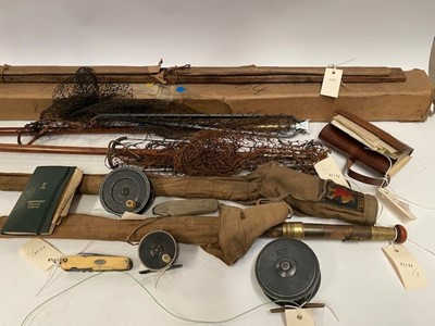 Lot 229 - A selection of fishing rods, reels and accessories