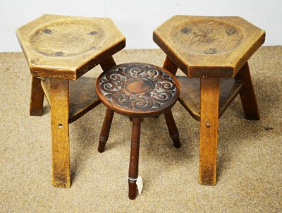 Lot 84 - Two oak milking stools and another stool