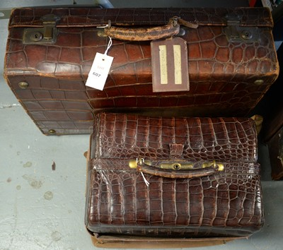 Lot 607 - Early 20th C crocodile skin travel trunk; and an alligator skin doctor's bag.