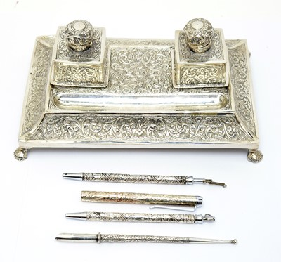 Lot 209 - A white metal Indo-Persian pen and ink stand