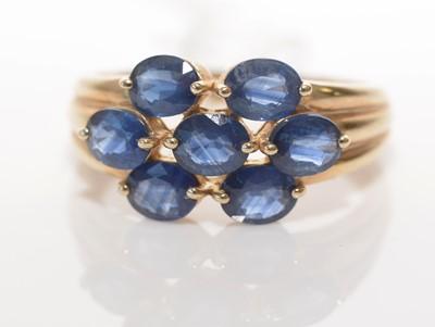 Lot 185 - Seven-stone Kanchanaburi sapphire cluster ring.