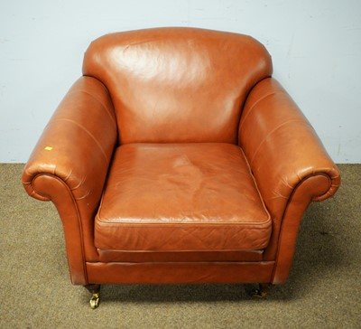 Lot 66 - Tanned leather upholstered open armchair.