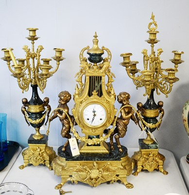Lot 248 - An Italian three piece clock garniture.