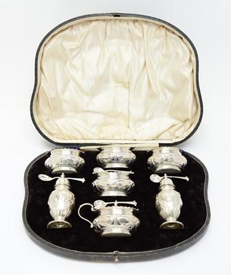 Lot 155 - An Edwardian cased silver cruet set
