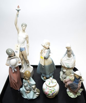 Lot 284 - A collection of six Lladro figurines and an Aynsley jar.