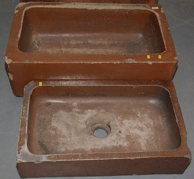 Lot 497 - A sink shaped planter and a similar smaller planter.