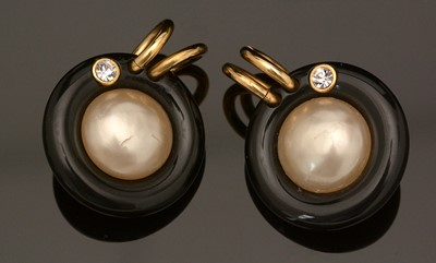 Lot 753 - Chanel: a pair of faux mabe-pearl, black plastic and gilt metal earrings