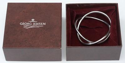 Lot 740 - Hans Hansen for Georg Jensen: sterling silver infinity bangle