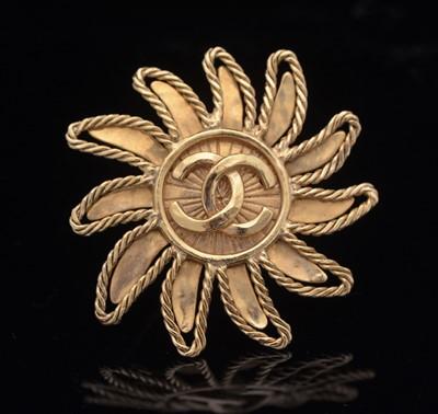 Lot 755 - Chanel: gilt metal sun brooch